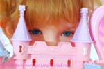 scared little girl hiding behind castle