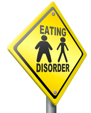 yellow sign with eating disorder people figure