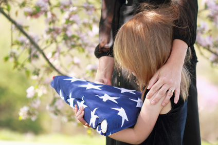 child with flag at funeral