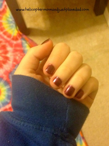 polished nails with plum polish