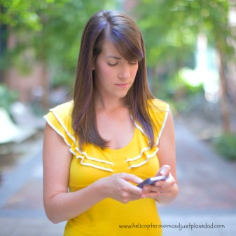 teen texting on phone