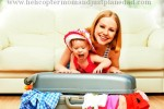 baby and mom with suitcase