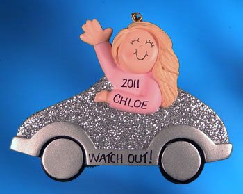 girl driving a silver car ornament