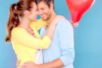 Couple hugging with a heart balloon