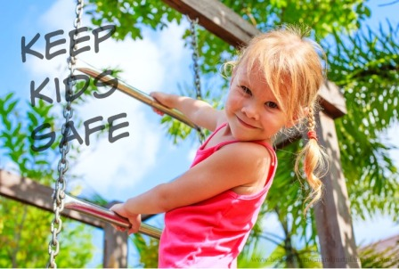 Little girl climbing near swing set