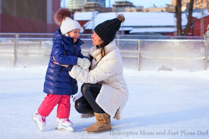 Mom and daughter ice skating