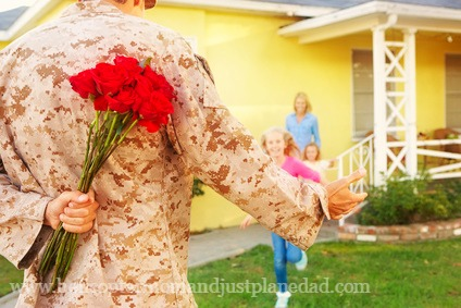 Soldier bringing flowers to his family